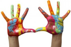 close up of child  hands painted with watercolors, on white background with clipping path